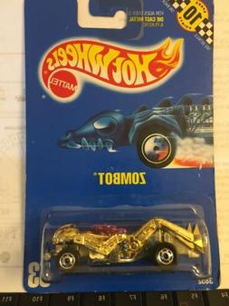 Hot Wheels - Zombot. Old Blue Card #53. Gold body with pink